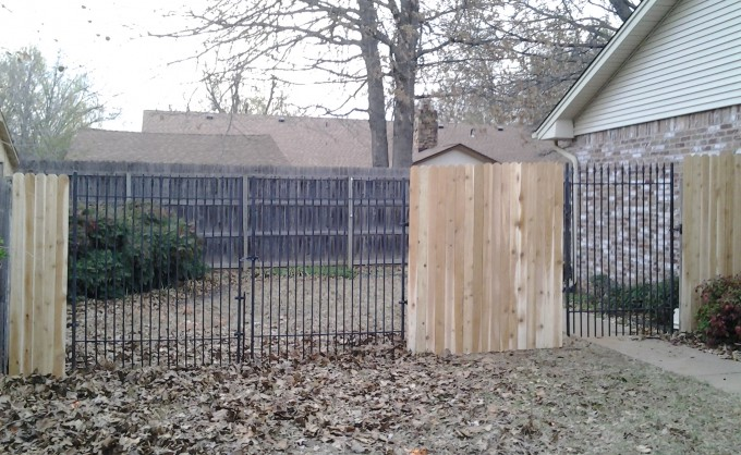 Iron Gates built into privacy fence